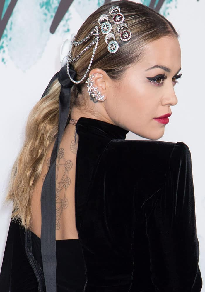 Rita puts her own twist to the look with badge hair pins