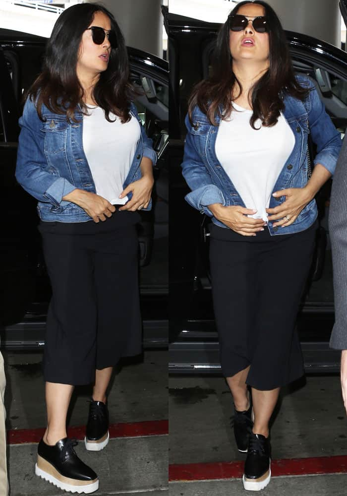 Cool and casual: Salma threw on a denim jacket by Unpublished Denim as she left Los Angeles