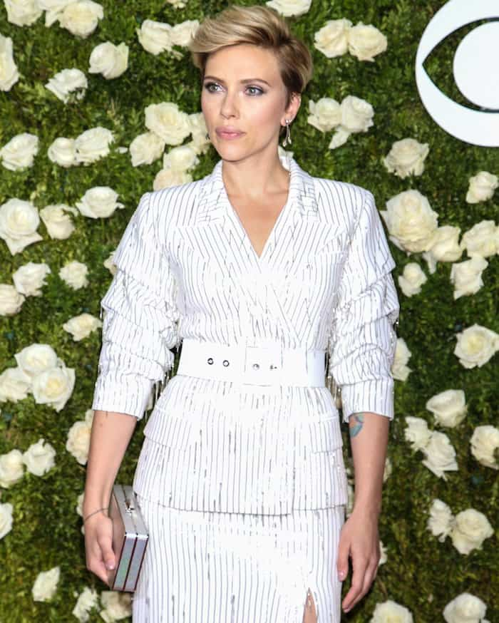 Scarlett Johansson finished off with chandelier earrings and a silver clutch