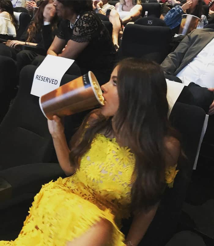 The actress uploads a photo of herself chowing down on some popcorn