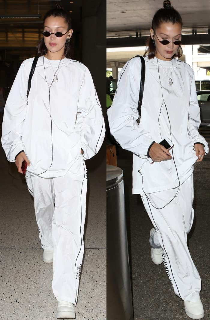 Bella Hadid wearing a Hyein Seo tracksuit top and pants styled with Celine pull-on sneakers at LAX