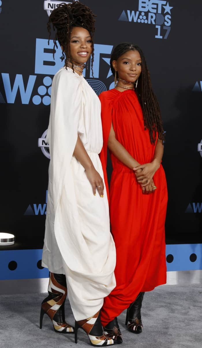 Chloe and Halle Bailey wearing Ms MIN dresses and Rodarte boots at the 2017 BET Awards