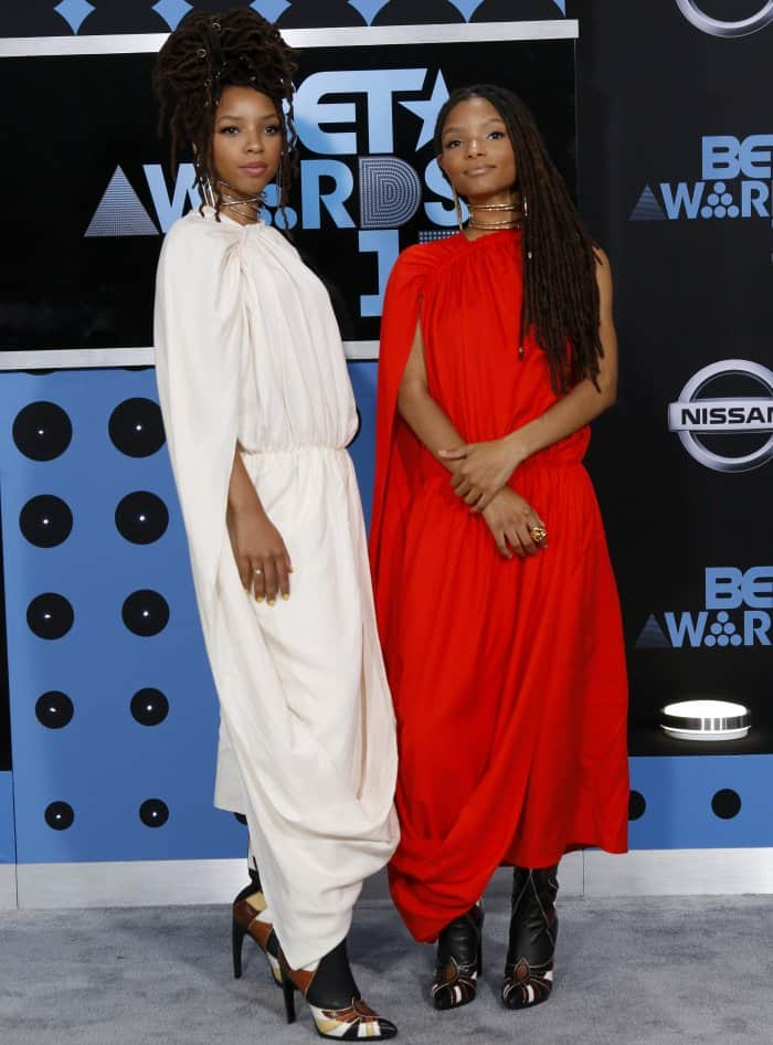Chloe and Halle Bailey added their own touches to their coordinating looks with different hairstyles and accessories
