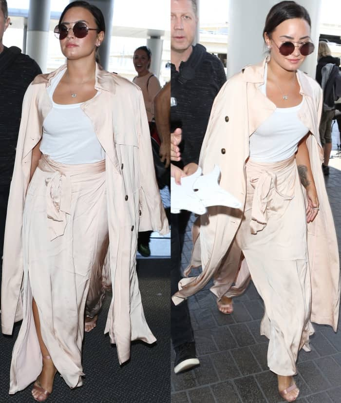 "Demi Lovato wearing an ATM tank top, Elizabeth and James coat and skirt, and Gianvito Rossi ""Portofino"" sandals in blush satin"