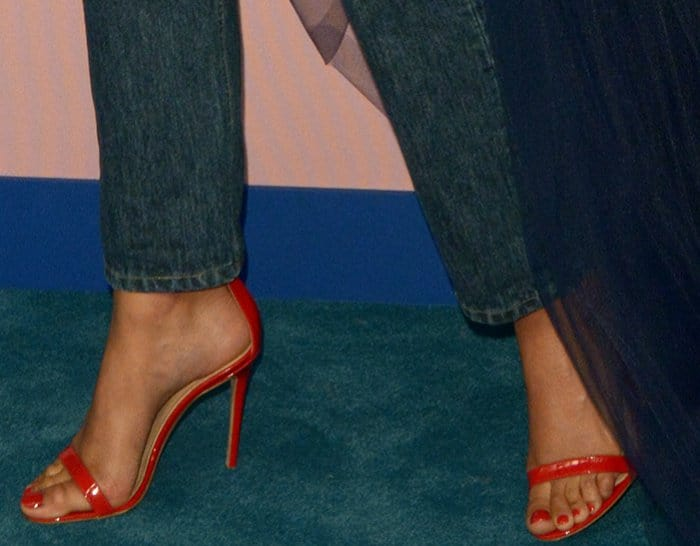 Imaan Hammam's pretty feet in red sandals