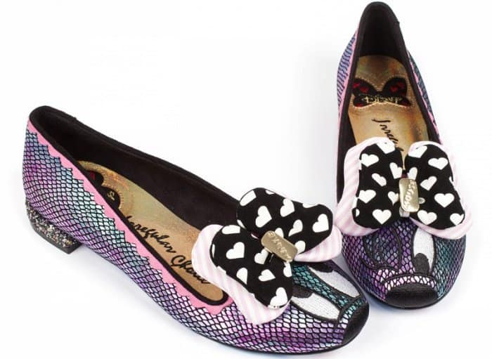 These shoes feature an iridescent oil slick effect, a slip-on style, and a Minnie Mouse embroidery detail