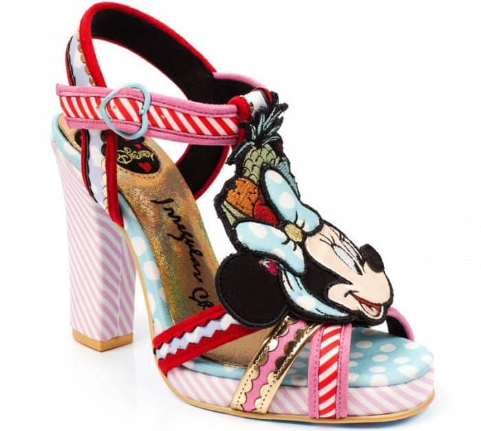 These strappy chunky sandals feature a tropical theme with fruit appliques and a Minnie Mouse character embellishment