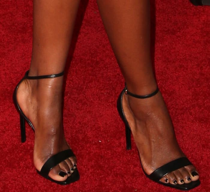 Justine Skye showing off her feet in Saint Laurent sandals