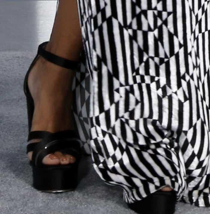 Kat Graham showing off her feet inblack platform sandals