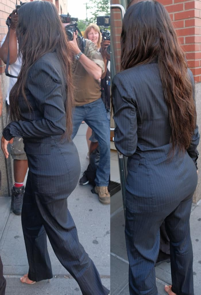 Kim Kardashian wearing a vintage Jean Paul Gaultier suit and Yeezy sandals in New York City