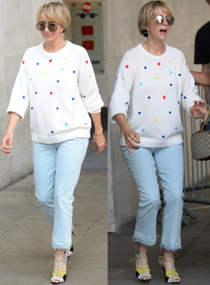 """Kristen Wiig wearing a Tory Sport sweater, cropped blue jeans, and Pierre Hardy """"Alchimia"""" sandals at the BBC Radio 1 studios"""