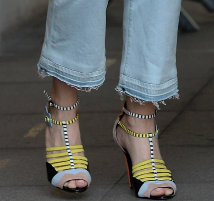 "Kristen Wiig wearing Pierre Hardy ""Alchimia"" sandals at the BBC Radio 1 studios"