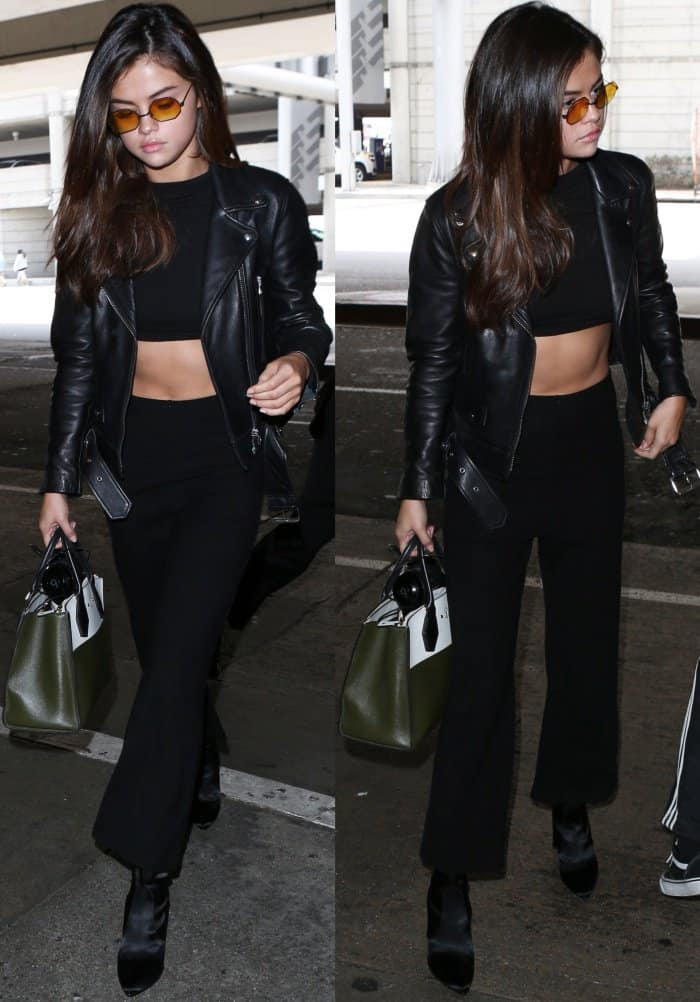 """Selena Gomez wearing an all-black ensemble styled with Stuart Weitzman """"Clinger"""" booties at LAX"""