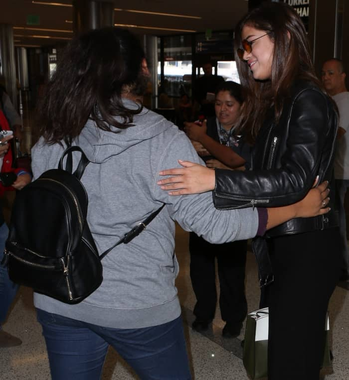 Selena Gomez with fans at LAX
