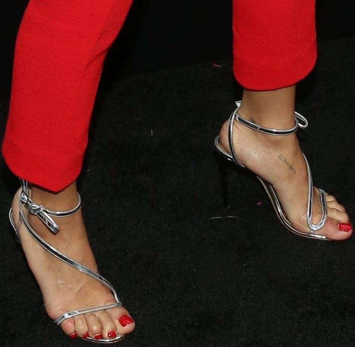 "Zoe Kravitz wearing Oscar de la Renta ""Romy"" metallic leather sandals at the ""Rough Night"" New York premiere"