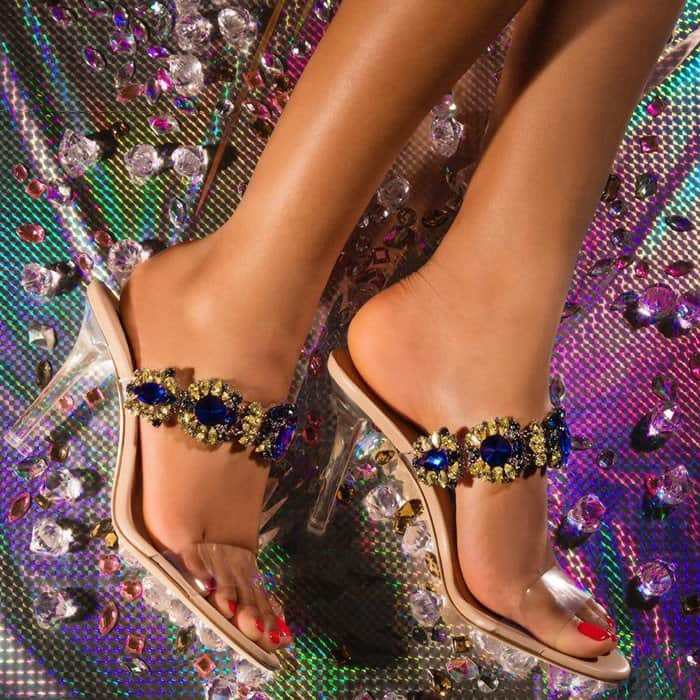 These barely-there sandals are lavishly adorned with blue Swarovski crystals on the front straps