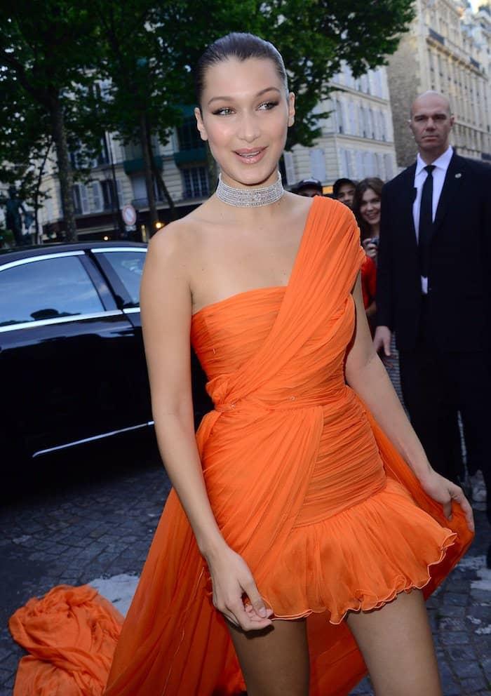 Bella Hadid in a Giambattista Valli Spring 2017 dress and Christian Louboutin crystal-embellished 'Iriza' pumps