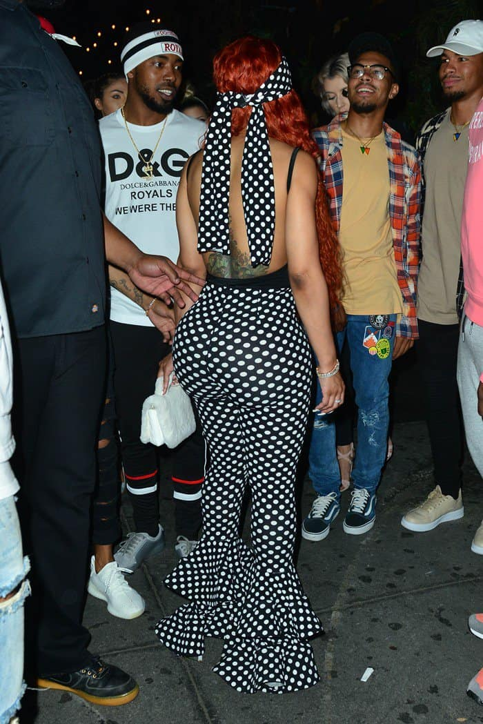 Blac Chyna debuted her fiery red tresses in polka dot ruffle pants from the Shane Justin Collection paired with a cleavage-baring black bodysuit