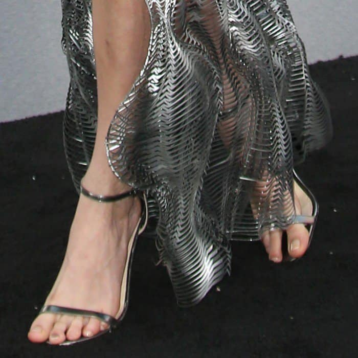 Cara showing off her feet in matching heels from Jimmy Choo