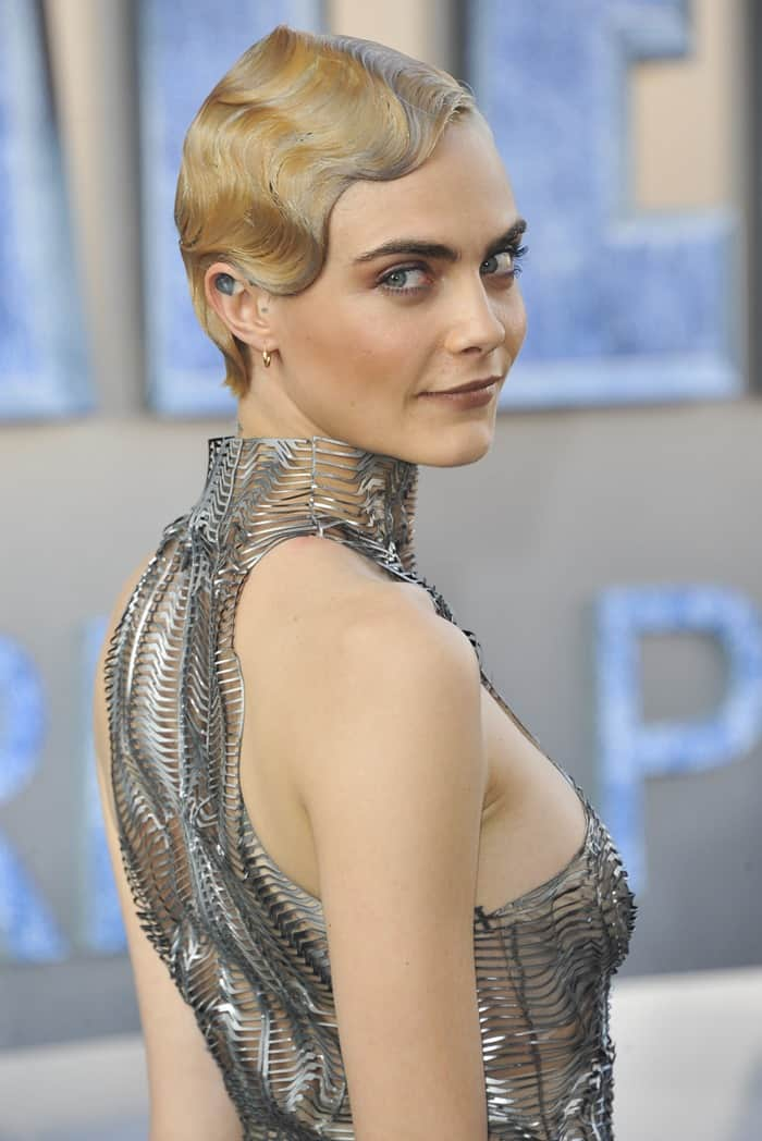 Cara Delevingne styled her futuristic dress with Repossi jewelry