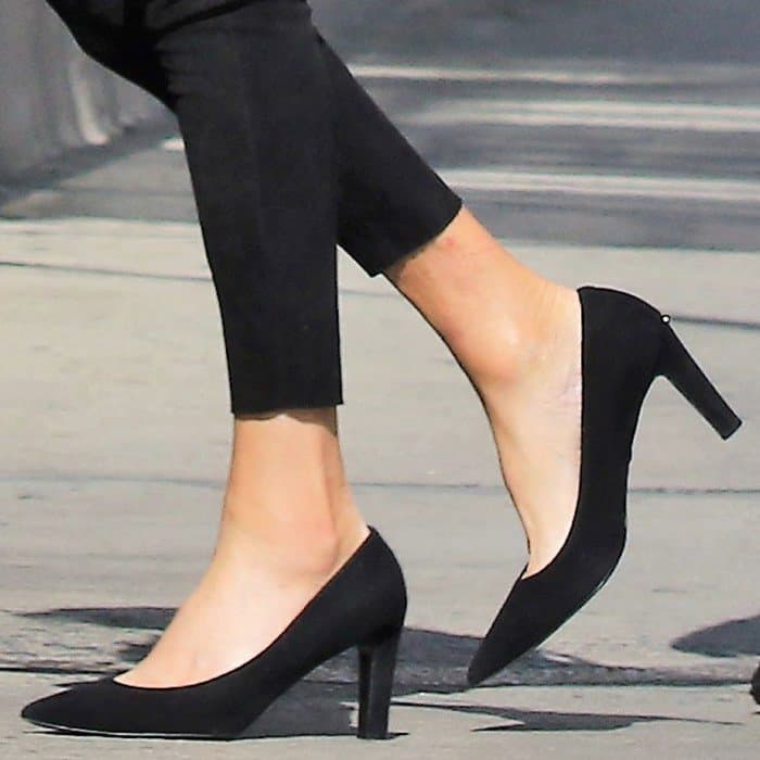 Caitlyn Jenner in black suede pointy-toe pumps