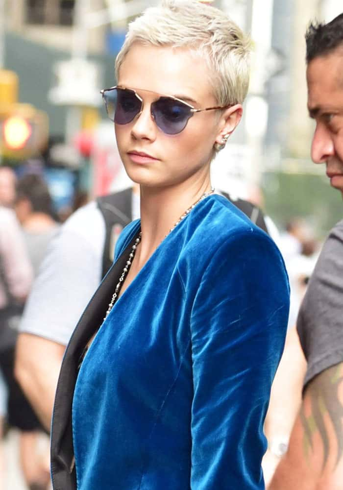 """Cara looked chic in blue-tinted """"So Real"""" sunglasses from Christian Dior"""