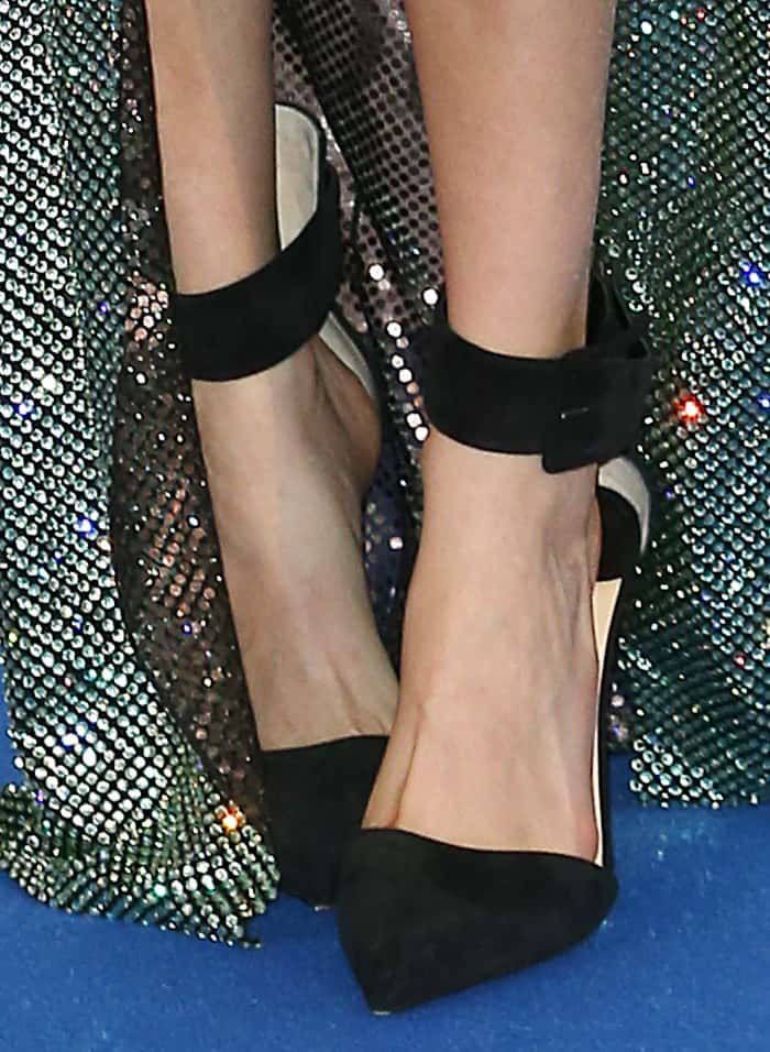 Cara Delevingne paired her dress with Christian Louboutin 'Harler' pumps in black suede