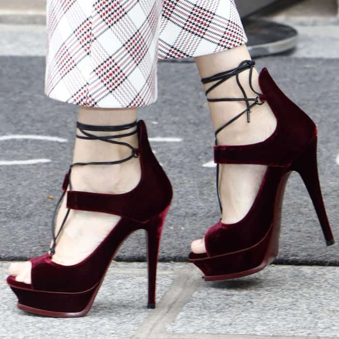 The pop icon towered in a gorgeous pair of velvet Saint Laurent sandals
