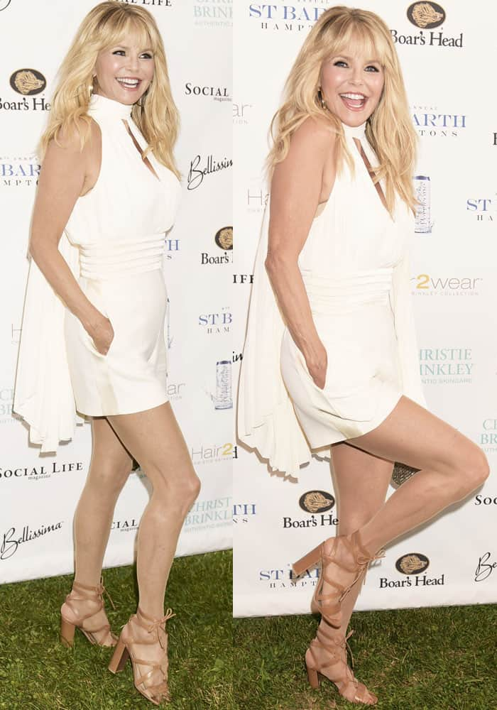 A vision in white: Christie shows off her well-maintained body in a caped playsuit