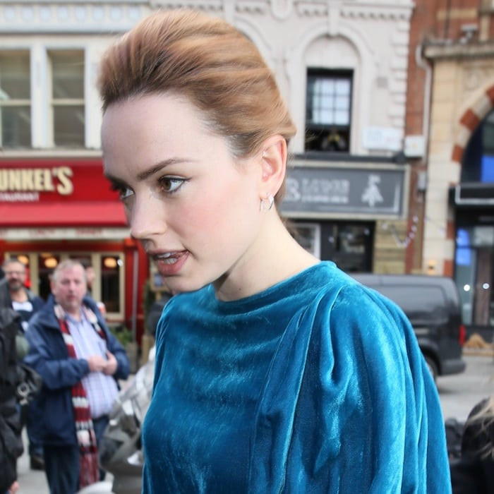Daisy Ridley showing off hernew lighter strawberry blonde hair color while heading into Global studios in London on March 9, 2018