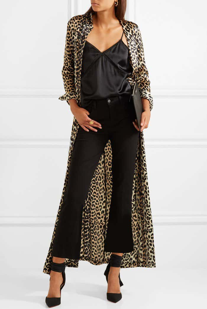 Model wearing black 'Douce du Desert' pumps with a 'Dufort' leopard-print silk-blend satin maxi dress from Ganni, a 'Bailey' chiffon-trimmed silk-charmeuse camisole from Cami NYC, and L'Agence's 'Serena' jeans that are made from soft black denim