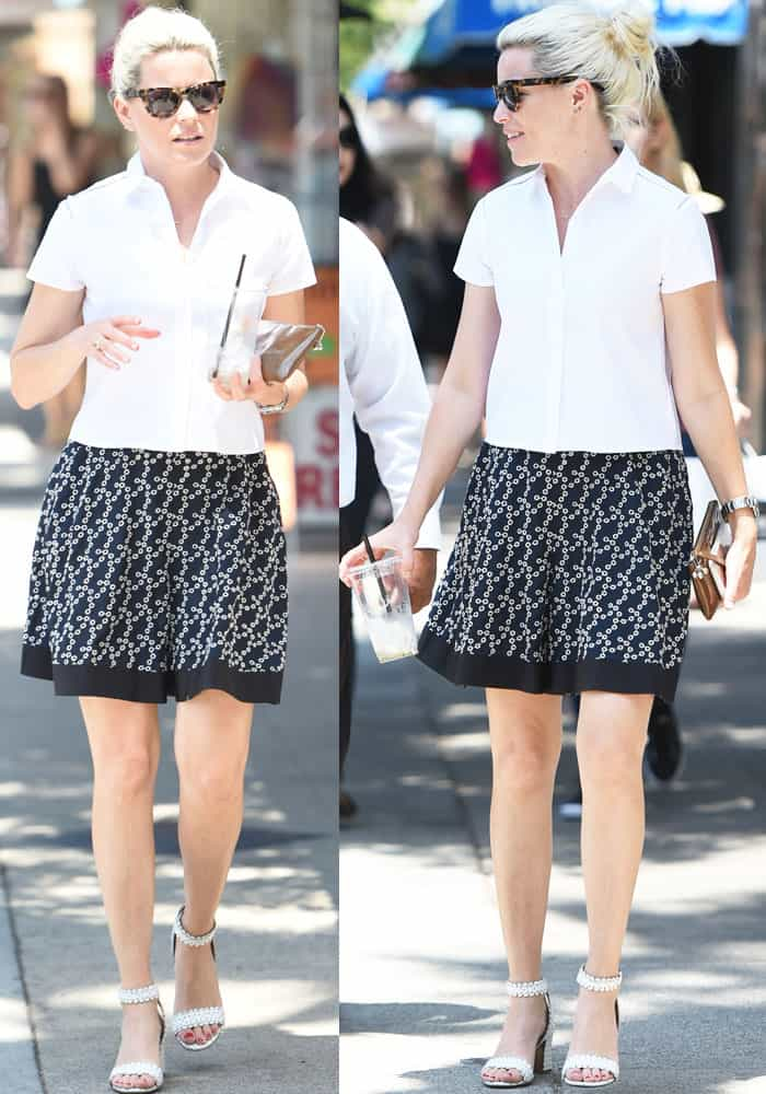 Elizabeth looks casual in a buttondown and print skirt