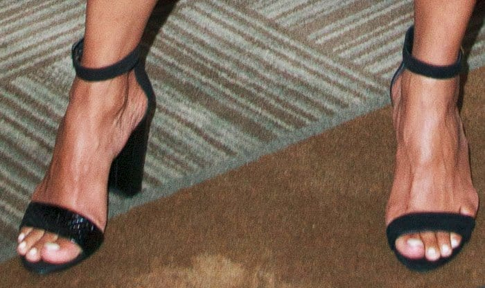 """Halle wears an Aquatalia sandal on one foot and a Kenneth Cole """"Deborah"""" on the other"""