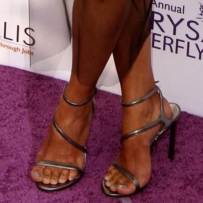 Halle Berry showing off her pedicure in strappy metallic sandals