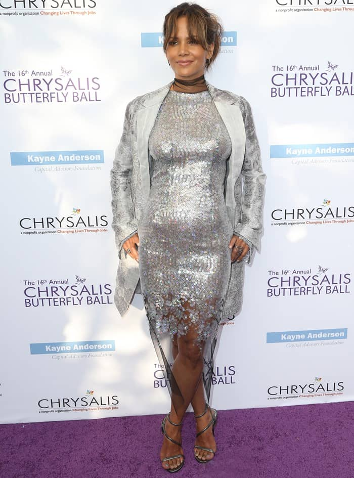 Halle Berry in tight silver dress at the 16th Annual Chrysalis Butterfly Ball held at a private residence in the Brentwood County Estates in Mandeville Canyon in Los Angeles, California, on June 3, 2017
