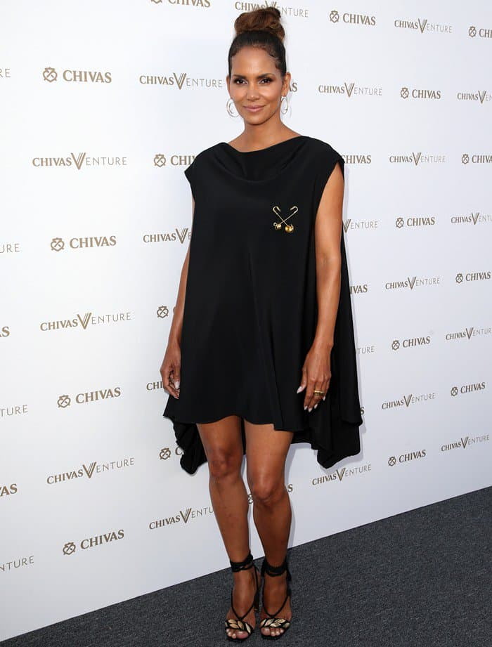 Halle Berry in a black cape-like mini dress at The Final Pitch event hosted by Chivas Regal at the LADC Studios in Los Angeles on July 13, 2017
