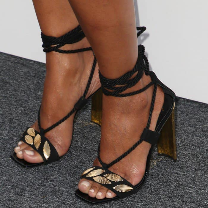 Halle Berry wearing black suede wraps sandals with leaf accessories from Giuseppe Zanotti