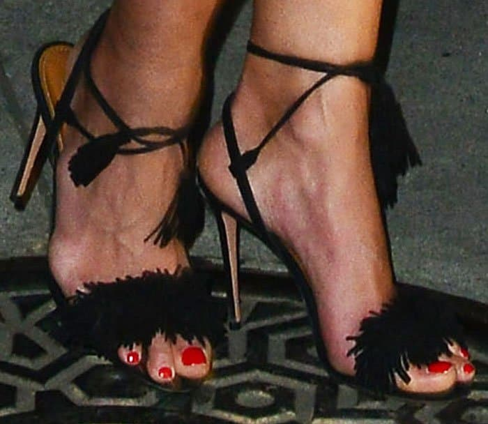 "Jordana inserted a bit of fun into her look with the fringed Aquazzura ""Wild Thing"" sandals"