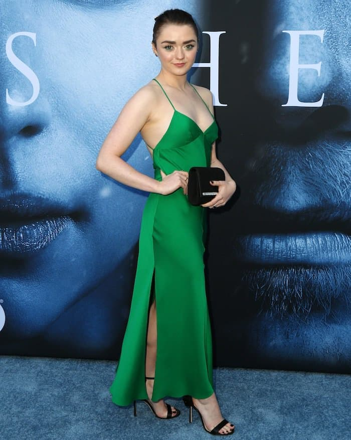 Maisie Williams wore a sleeveless green silk dress with thin crisscross back straps and side slits