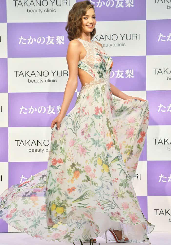 Miranda twirls around in a creation by American-based Japanese designer Tadashi Shoji