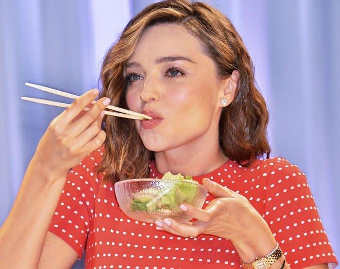 Miranda samples a salad at her organic miso promotions