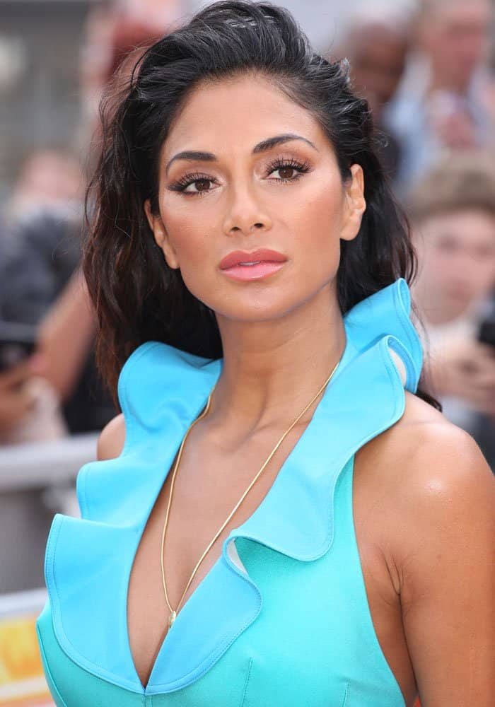 Nicole Scherzinger strayed away from her neutrals and army greens for a more risqué color