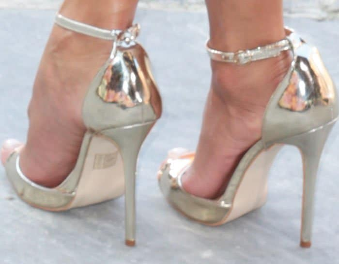 """Nicole towers in a pair of Jimmy Choo """"Tori"""" sandals"""