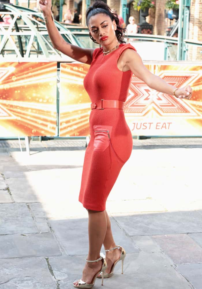 """Nicole playfully dances for the paparazzi outside the """"X Factor"""" studio"""