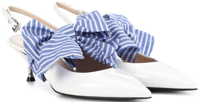 This pointed-toe silhouette is set on a sleek kitten heel and finished with a bold blue and cream striped scarf tied in a playful bow at the upper