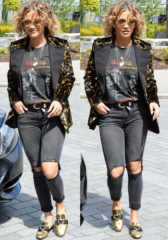 The pop star was spotted in a vintage Oasis concert tour shirt