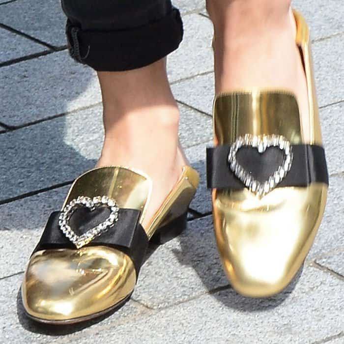 """Rita puts the finishing touches on her look with a pair of Bally """"Phylis"""" metallic leather slippers"""