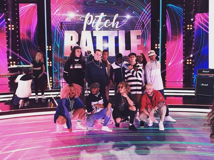 """The pop star snaps a photo with her backup dancers during rehearsals at """"Pitch Battle: Live Final"""""""