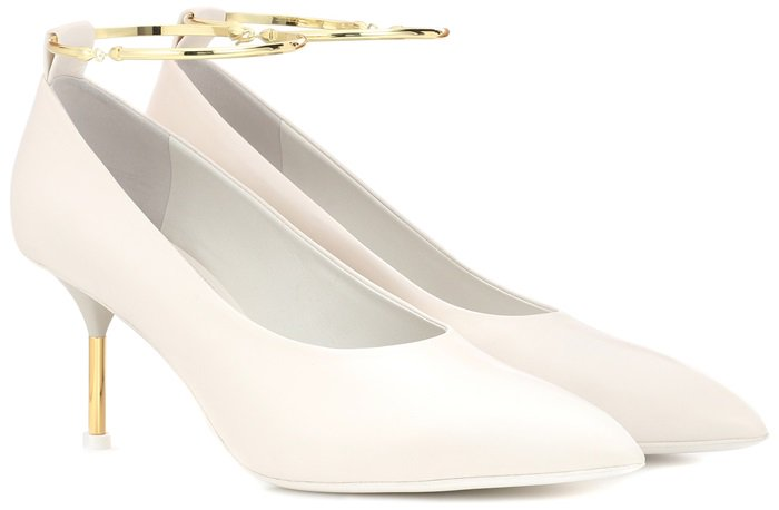 Made in Italy from smooth white leather, with a high-cut vamp for a contemporary feel, they're accented with a polished golden metal ankle strap and coordinating heel