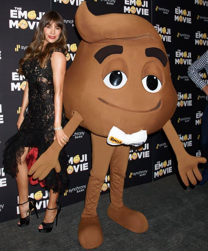 Sofia poses beside the hilarious poop emoji